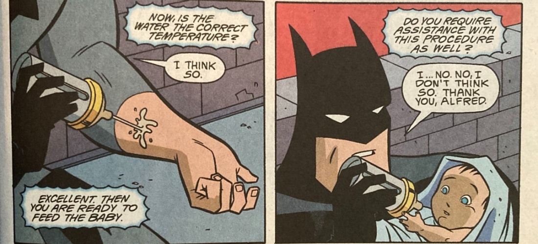 batman feeds a baby
