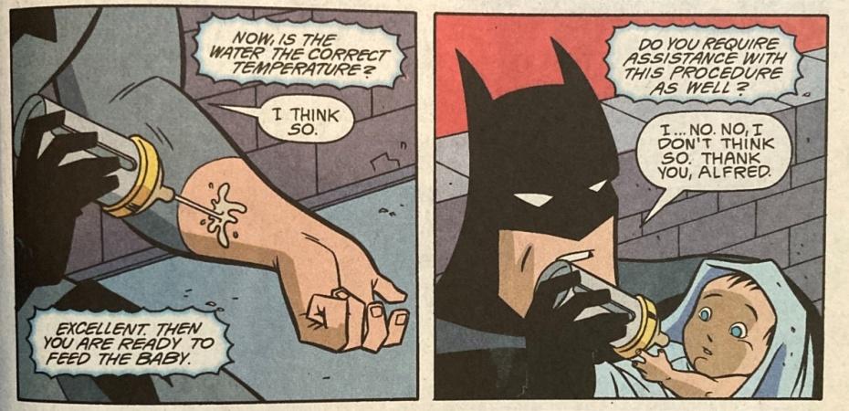 batman feeds a baby